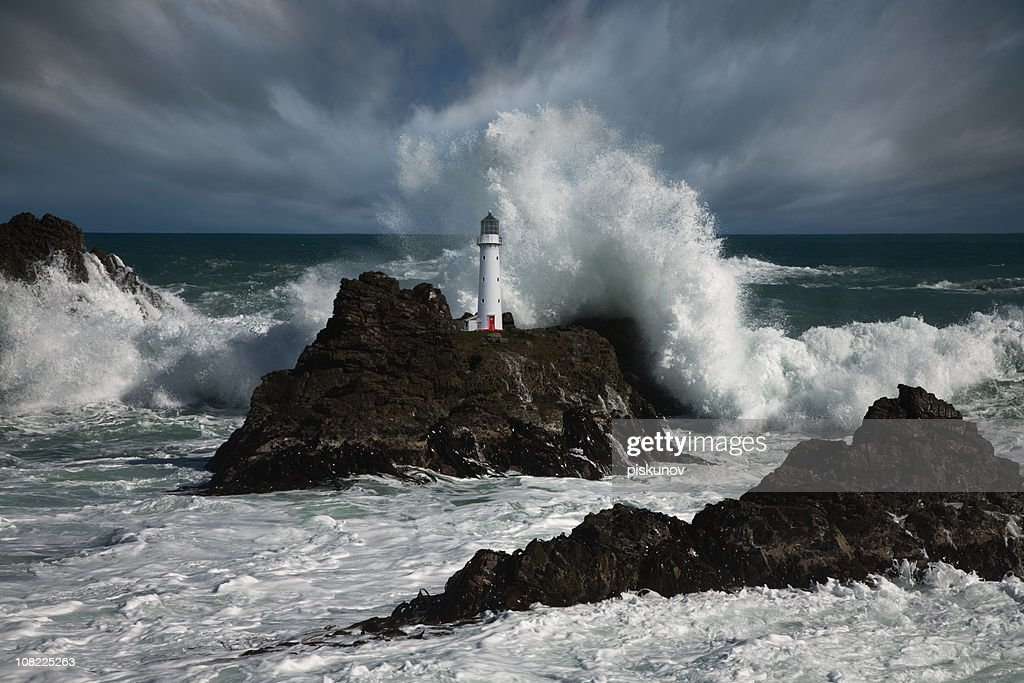 Lighthouse at storm : Stock Photo