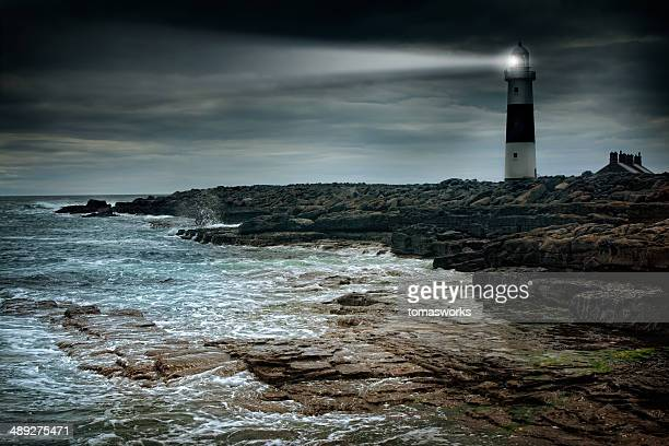lighthouse at stormy irish coast