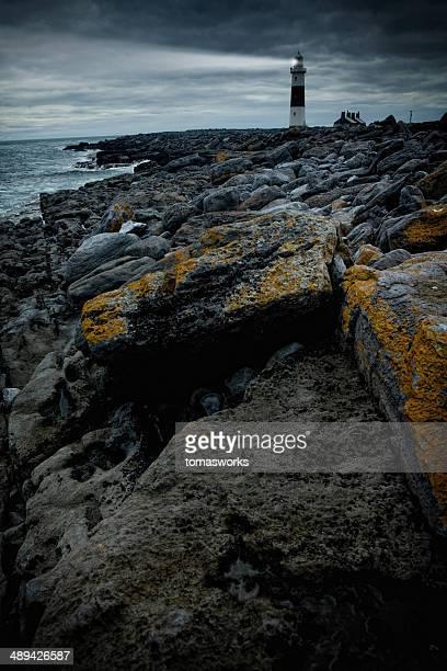 lighthouse at stormy irish coast