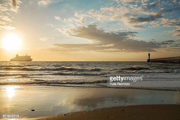 lighthouse at sunset in calais - calais stock-fotos und bilder