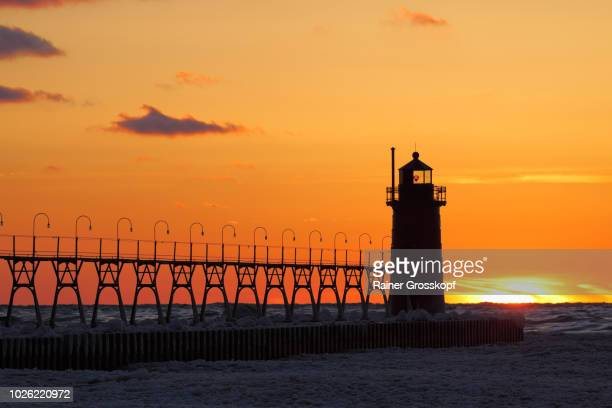 Lighthouse at sunset in winter