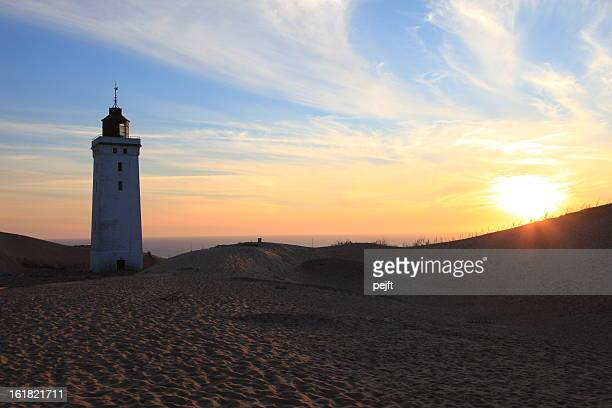 lighthouse at sunset rubjerg knude fyr , jylland - denmark - pejft stockfoto's en -beelden