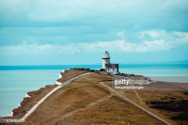 lighthouse at the cliffs of eastbourne - rural scene stock pictures, royalty-free photos & images
