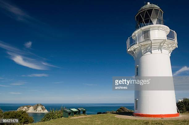 lighthouse at the east cape - gisborne stock photos and pictures