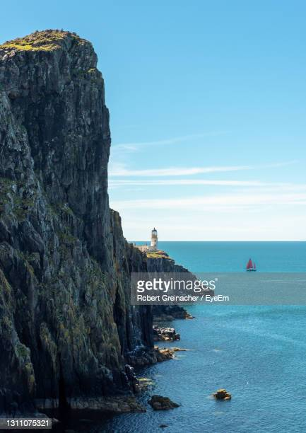 lighthouse at the end of the world - idyllic stock pictures, royalty-free photos & images