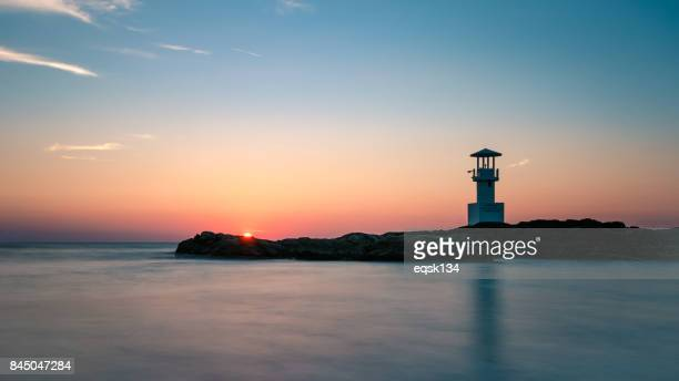 lighthouse at the sunset moment at khao lak with twilight sky - rocky coastline stock pictures, royalty-free photos & images