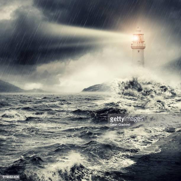 lighthouse beacon - leuchtturm sturm stock-fotos und bilder