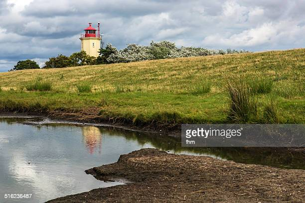 Lighthouse behind the dike