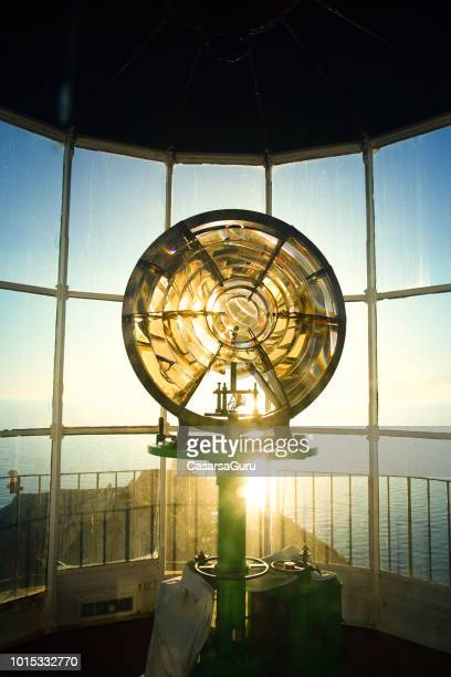 lighthouse bulb against panoramic view - lighthouse stock pictures, royalty-free photos & images