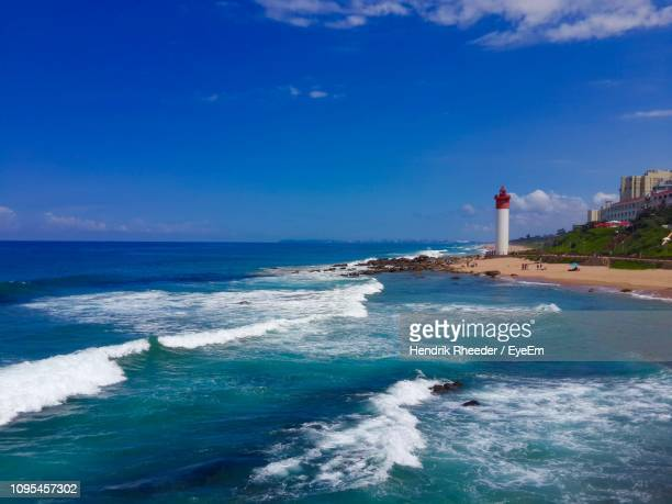 lighthouse by sea against sky - reed dance stock pictures, royalty-free photos & images