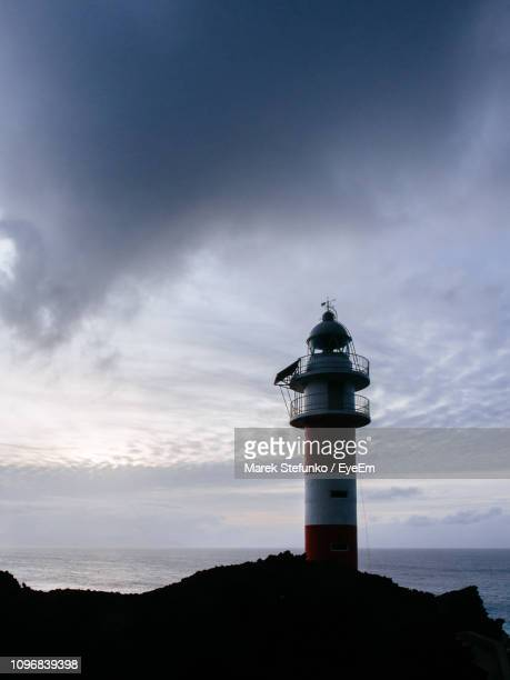 lighthouse by sea against sky - marek stefunko stock pictures, royalty-free photos & images