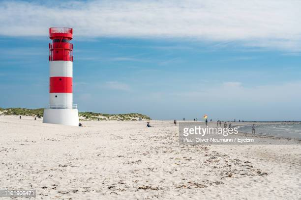 lighthouse by sea against sky - helgoland stock pictures, royalty-free photos & images