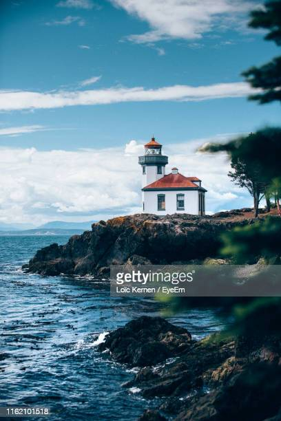 lighthouse by sea against sky - san juan stock pictures, royalty-free photos & images