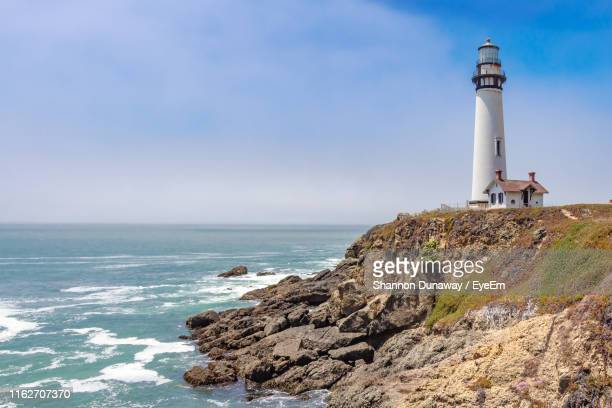 lighthouse by sea against sky - san mateo county stock pictures, royalty-free photos & images