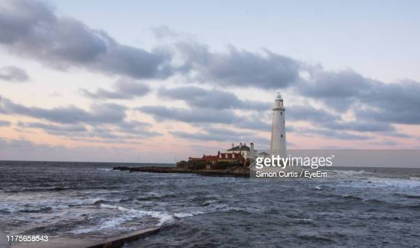lighthouse by sea against sky - whitley bay stock pictures, royalty-free photos & images