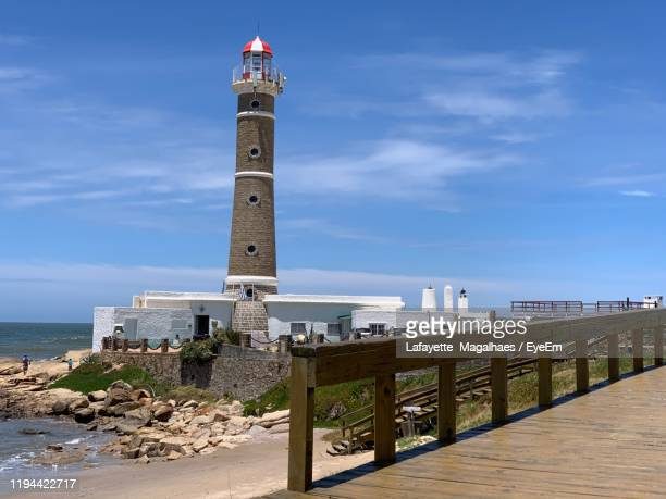 lighthouse by sea against sky - jose ignacio lighthouse stock pictures, royalty-free photos & images