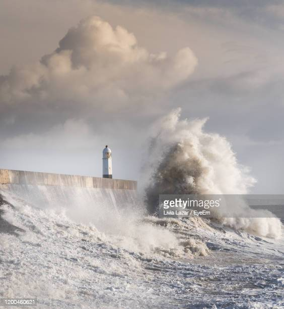lighthouse by sea against sky - porthcawl stock pictures, royalty-free photos & images