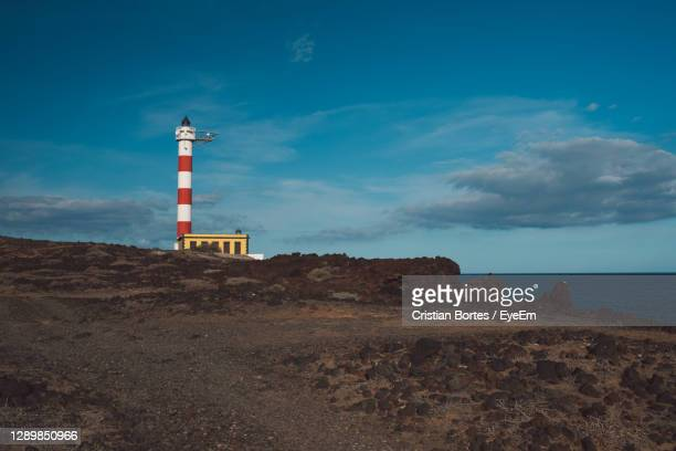 lighthouse by sea against sky - bortes stock pictures, royalty-free photos & images