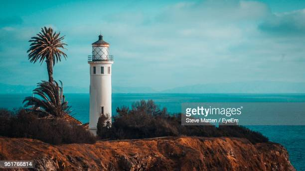 lighthouse by sea against sky - steve matten stock pictures, royalty-free photos & images