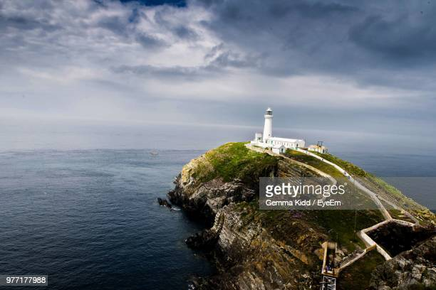 lighthouse by sea against sky - south yorkshire stock pictures, royalty-free photos & images