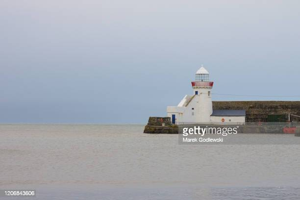 lighthouse calm before storm dennis- balbrigan, ireland - storm dennis stock pictures, royalty-free photos & images