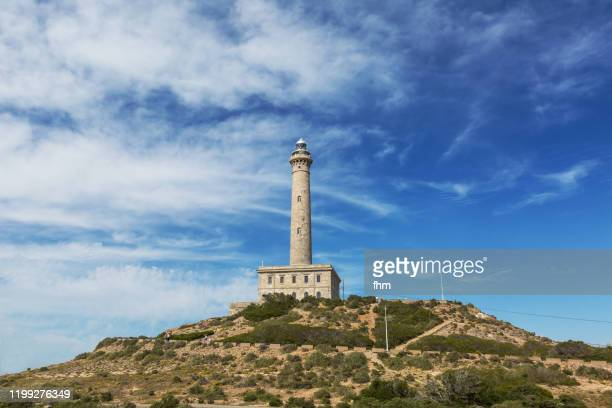 lighthouse cape palos (spain) - la manga stock pictures, royalty-free photos & images