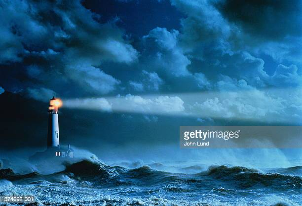 lighthouse casting beam of light over stormy sea (enhancement) - lighthouse stock pictures, royalty-free photos & images