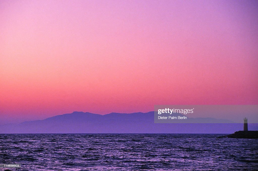 Lighthouse From Sea At Sunset Stock Photo - Getty Images