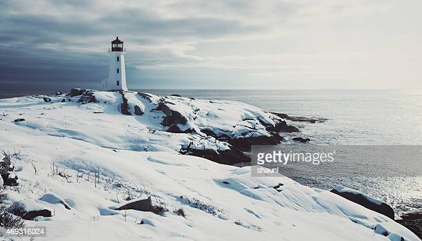 lighthouse in fresh snow - atlantic ocean stock pictures, royalty-free photos & images