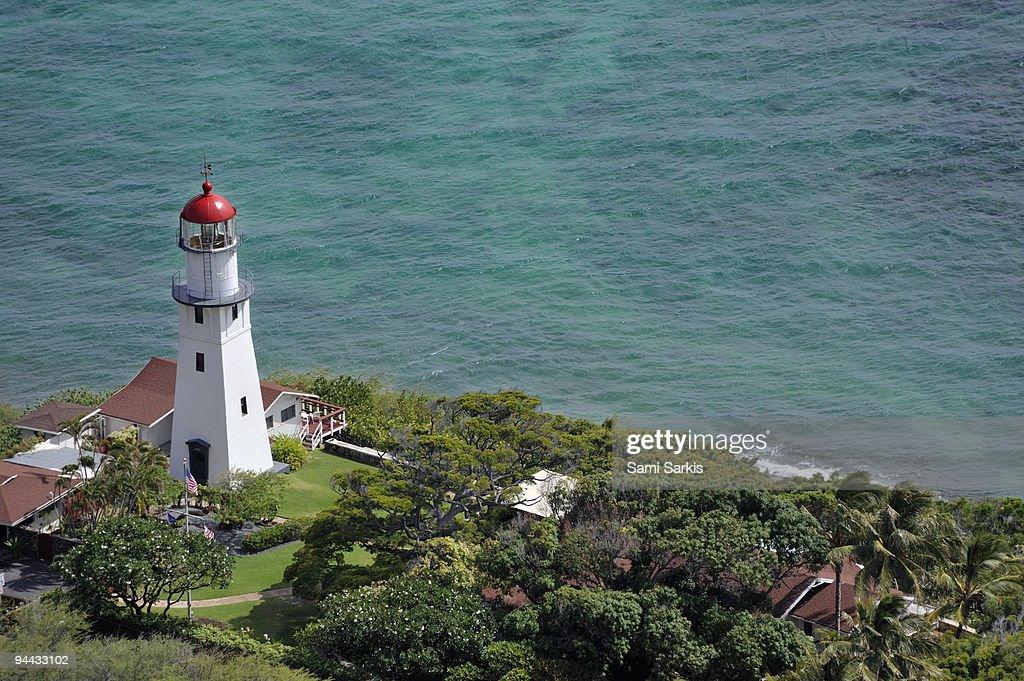 Lighthouse in garden on Pacific Ocean : Stock Photo