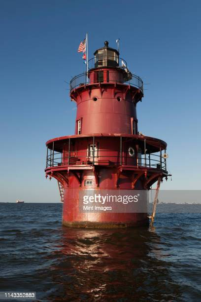 lighthouse in ocean - chesapeake bay stock pictures, royalty-free photos & images