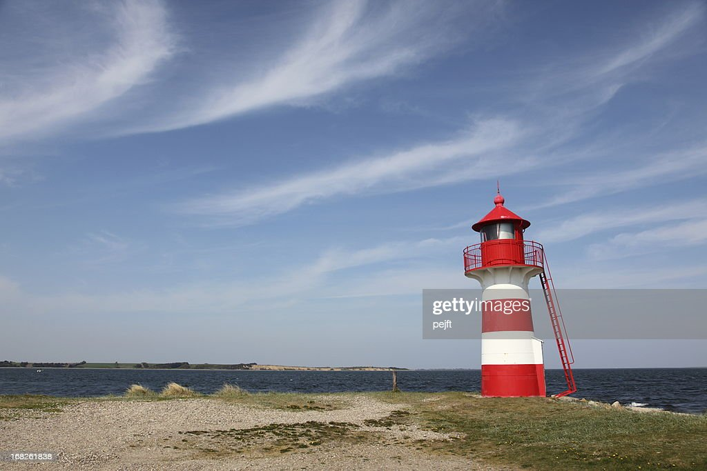 Lighthouse in red and white at Grisetaa Odde : Stock Photo