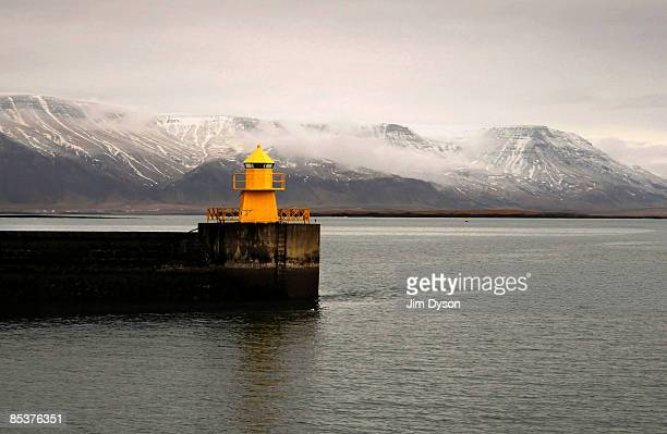 Lighthouse in Reykjavik harbour on February 22, 2009 in Reykjavik, Iceland. A country of glacial and volcanic geology, with a rich historic tradtion,...