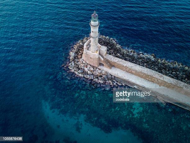 lighthouse in the ocean - seascape stock pictures, royalty-free photos & images