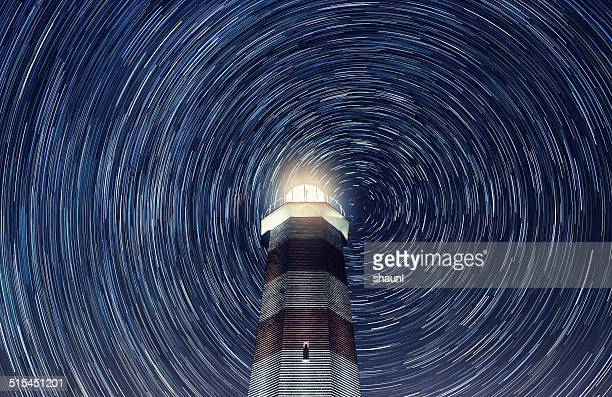 lighthouse in the stars - north star stock photos and pictures