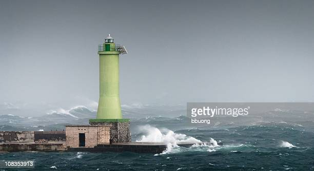faro di tempesta - europa meridionale foto e immagini stock