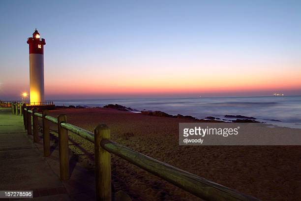 lighthouse just before sunrise - durban beach stock photos and pictures