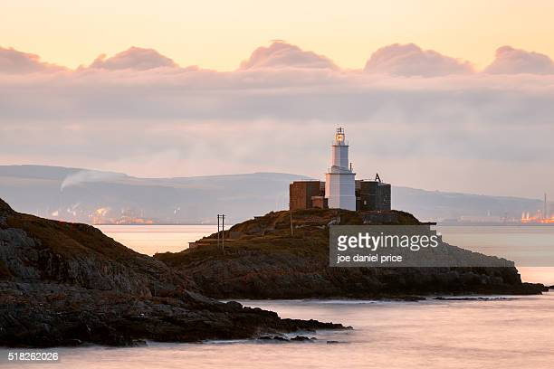 lighthouse, mumbles, gower peninsula, wales - gower peninsula stock photos and pictures