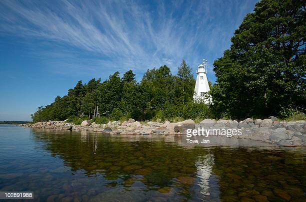 lighthouse near lake - dalsland stock photos and pictures
