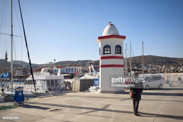 lighthouse of urla marina.. - emreturanphoto stock pictures, royalty-free photos & images