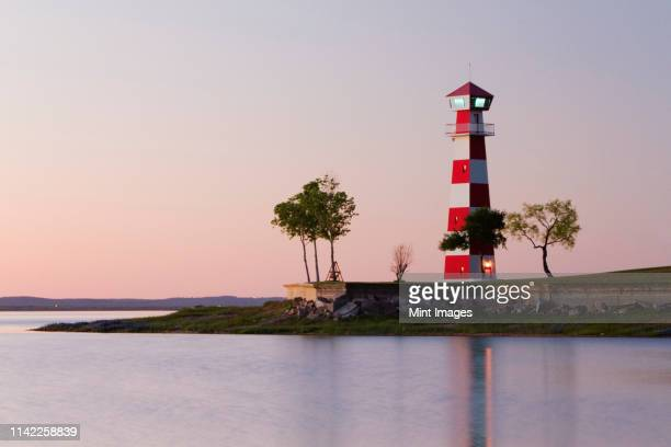 lighthouse on a beach - texas gulf coast stock photos and pictures