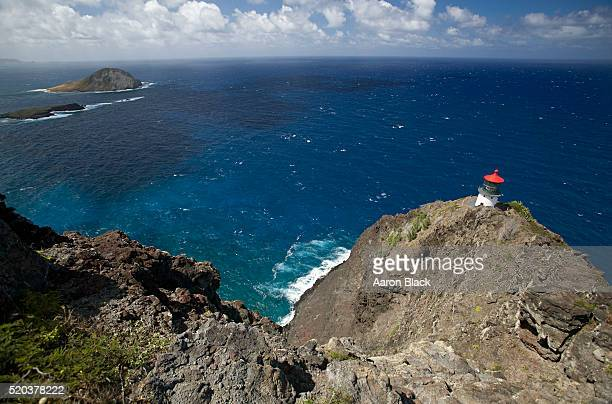 Lighthouse on a rocky outlook over the sea