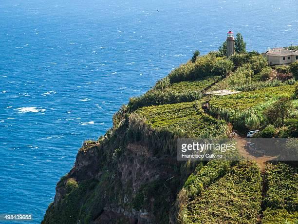 Lighthouse on cliff by Atlantic ocean Sao Jorge Madeira Portugal