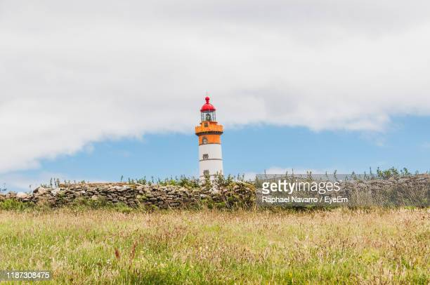 lighthouse on field against sky - semaphore stock pictures, royalty-free photos & images