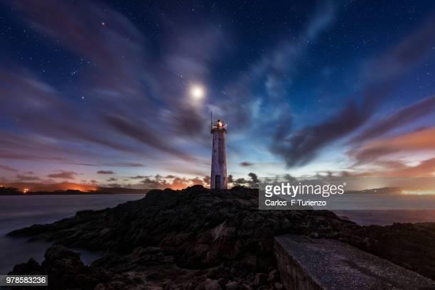 lighthouse on lake, muxia, galicia, spain - comunidad autónoma de galicia fotografías e imágenes de stock
