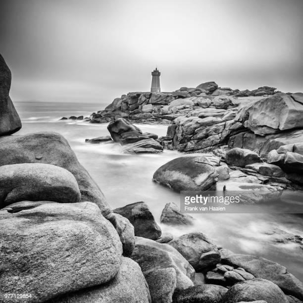 Lighthouse on rocky coast, Brittany, France
