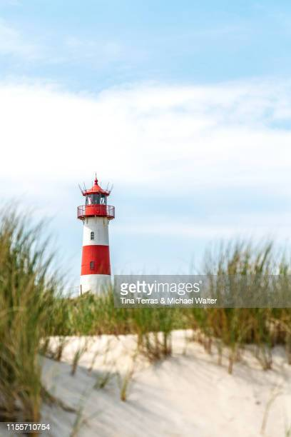 "lighthouse on the beach of sylt. ""ellenbogen"" - german north sea region stock pictures, royalty-free photos & images"