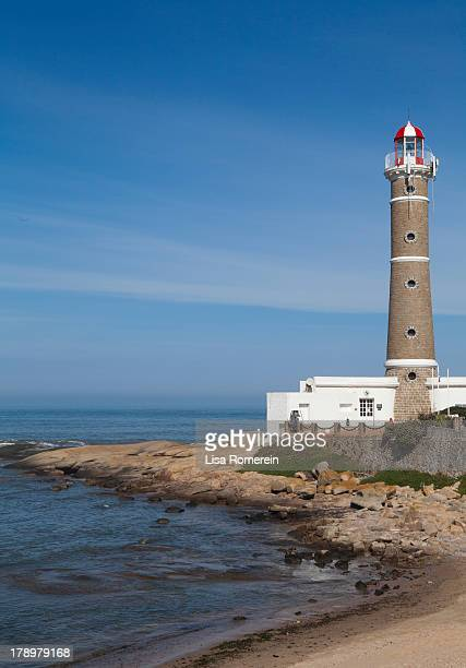 lighthouse on the ocean - jose ignacio lighthouse stock photos and pictures