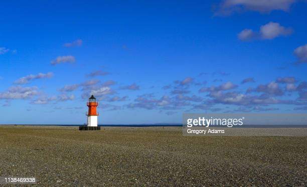 a lighthouse on the remote north shore of the isle of man - isle of man stock pictures, royalty-free photos & images