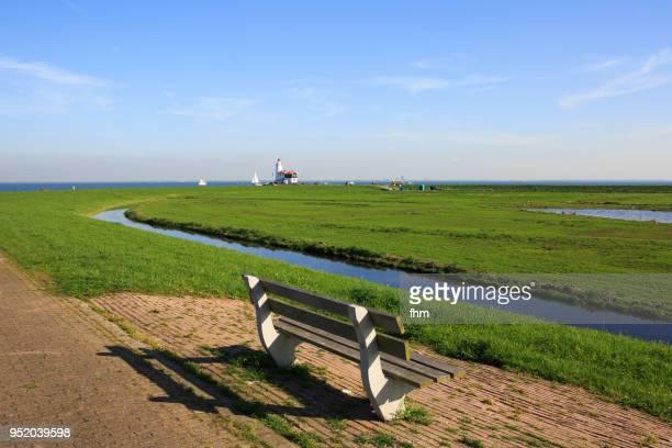 Lighthouse Paard van Marken with a bench (Marken, Netherlands)